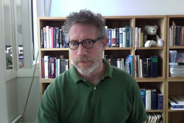 Welcome to My Home Page! 			A photo on this page shows me: 			curly grey-red hair, short beard and moustache, 			green eyes, black-frame glasses, fit, muscular, about 			5 ft. 11 inches tall.